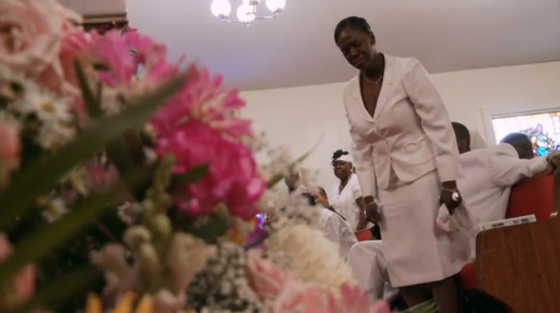 Woman At An African American Funeral In A Funeral Home