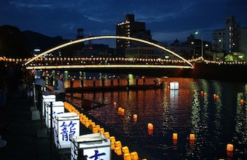 Lanterns floating on river during Obon Festival