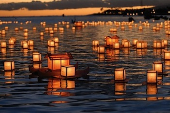 floating lanterns on river, obon festival