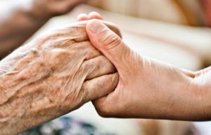 hospice care, hospice hands, elderly hands, holding hands
