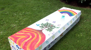 A cardboard coffin lovingly decorated by family