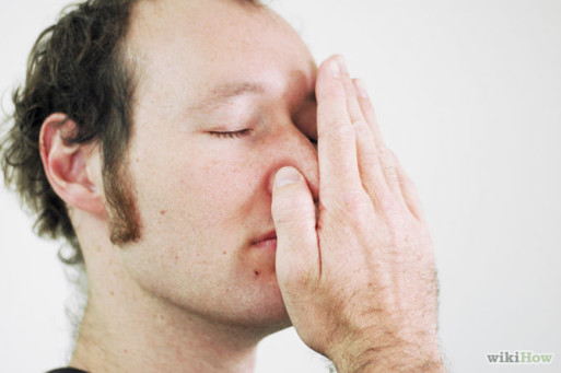 Man demonstrates hand position for left nostril breathing