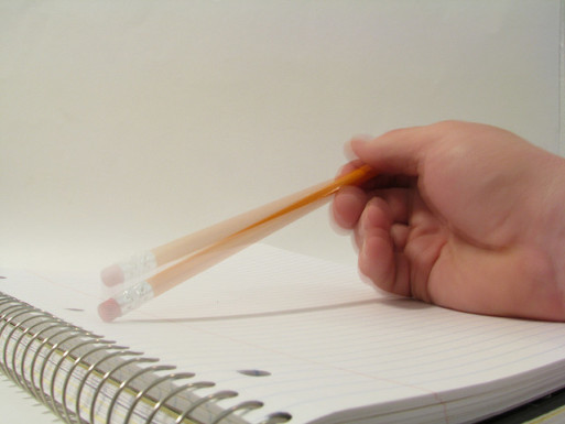 Someone tapping a pencil on a blank paper while estate planning