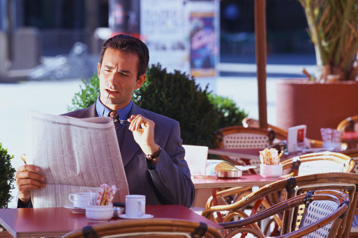 Businessman Reading Newspaper reflecting about life