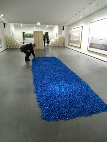 """Untitled"" (Placebo) art installation featuring thousands of pieces of blue candy on the ground"
