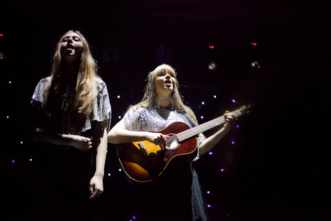 Sisters Klara and Johanna Söderberg, the musical duo First Aid Kit, singing about life after loss
