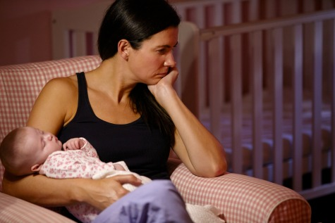 Mother with postpartum depression holding baby