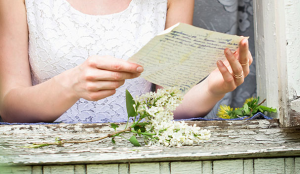 woman reading a letter to a lost loved one