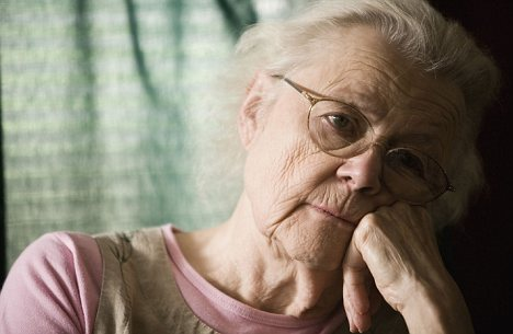 Elderly woman with dementia staring into space