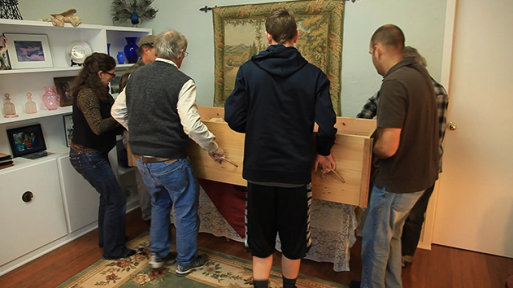Bringing a coffin in a home for a family-directed funeral