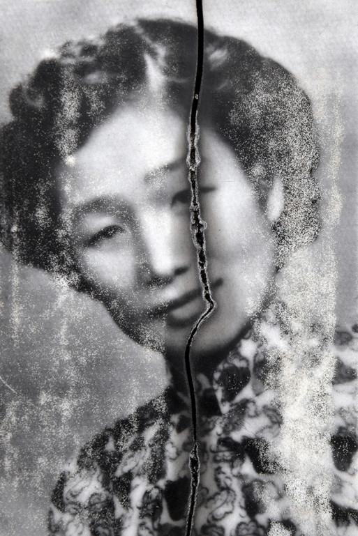 Faded tombstone portrait of an Asian woman