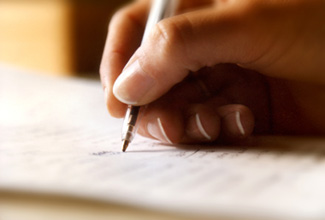 Hand of a person writing an ethical will
