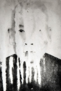 Portrait of an Asian man from his tomb, streaked and faded from time