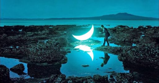 dream-like photo of a person, tidepool and moon shows grief journey