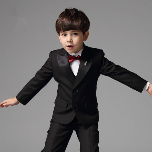 Boy in suit making fun at funeral