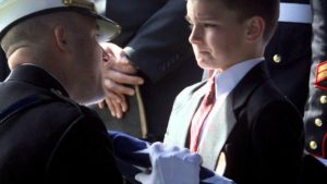 Military funeral rituals comfort young boy