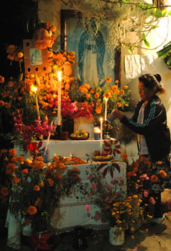 Woman at Day of the Dead altar