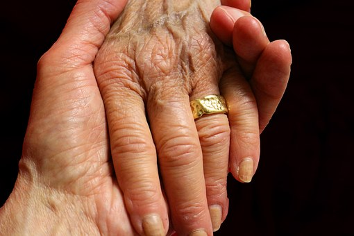 elderly hands healing touch