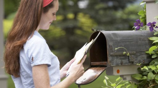 Woman getting her mail to be sure of no fraud