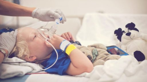 Child getting breathing treatment for terminal illness