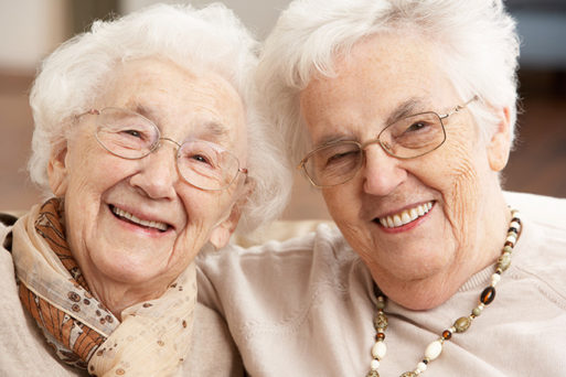 Two smiling healthy elderly women who are likely to outlive men