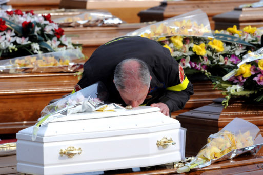 Man kisses the coffin of a child
