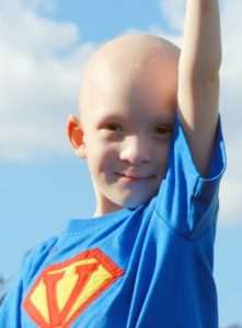 A child with cancer wearing a super hero costume