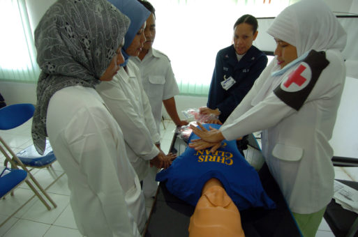 Nurses practice CPR on a dummy to prepare for treating patients who do not have full DNR orders