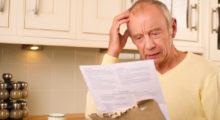 Senior man looking at a high medical bill