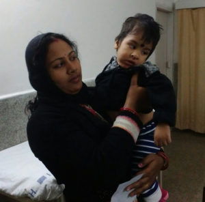 A caregiver and mother holds her son, who has developmental disabilities