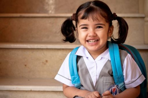 A school age girl with backpack may need childcare after a loss