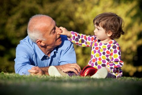 A senior man's need for support is met by spending time with his grandchild outdoors