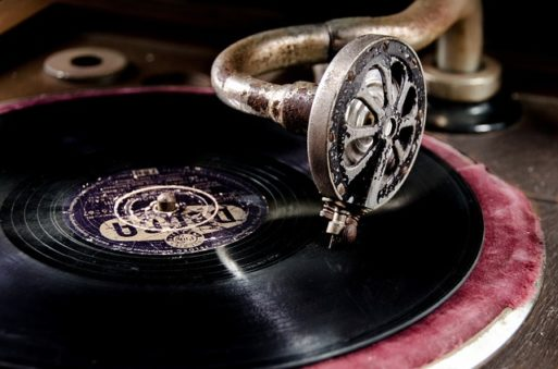 An old phonograph playing a record to drown out the death rattle