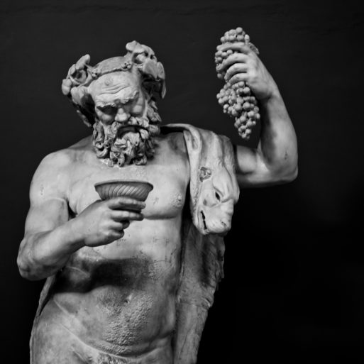 Greek statue with grapes sayings a joke about death