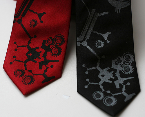 Bethany Shorb's Terminal Illnessties, featuring one red and one black tie with flu molecule designs on them