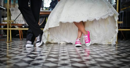 Shoes of hip bride and groom at funeral home weddings