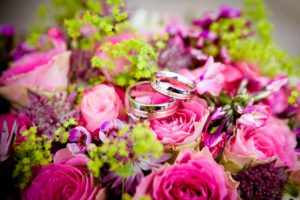 Wedding bands resting on top of flowers can be found at funeral home weddings