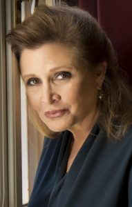 Actress Carrie Fisher posing and smiling