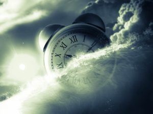 A clock in the clouds shows how time creeps by when caring for the dying: thoughts of I wish it was over are normal