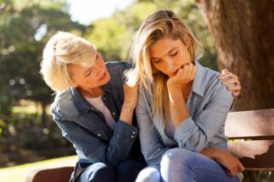 A woman helping a grieving friend know you are now alone