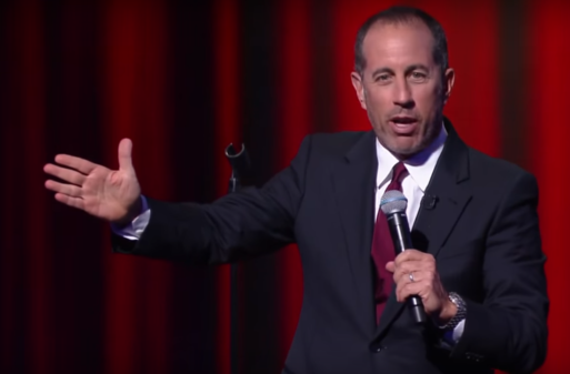 Jerry Seinfeld performing stand up comedy