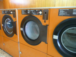 Three clothes dryers sitting side-by-side, the same kind used to dry bones in alkaline hydrolysis