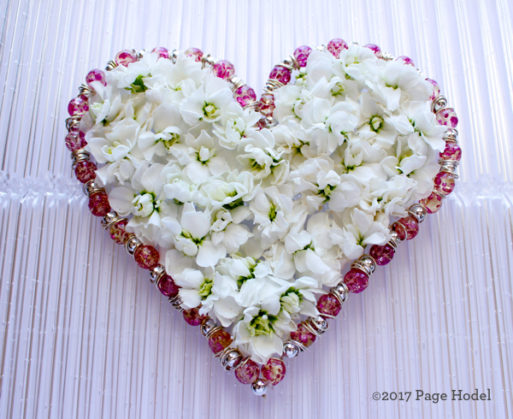 handmade heart of white and pink flowers