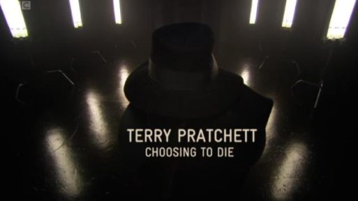A screenshot from Terry Pratchett: Choosing to Die showing Pratchett in the shadows, wearing a black fedora hat