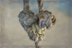 Rope tied into a heart shows pent up feelings about suicide