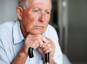 Loneliness on the face of an elderly man