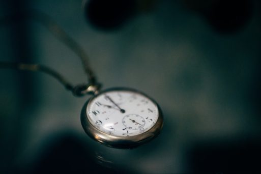 A wristwatch sitting on a table, representing the passing of time