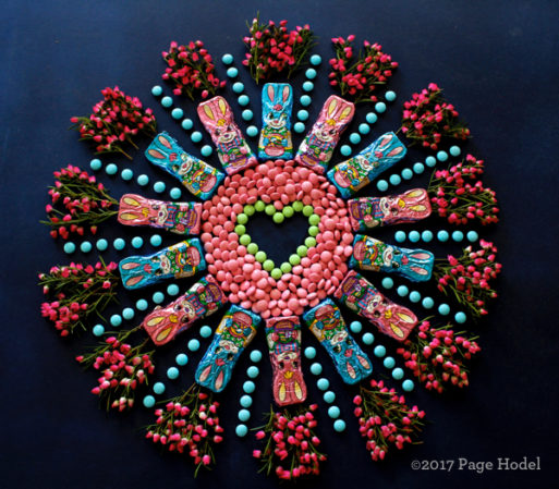 Handmade heart made of Easter candies and flowers