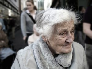 Elderly Woman looking away from camera symbolizing old age