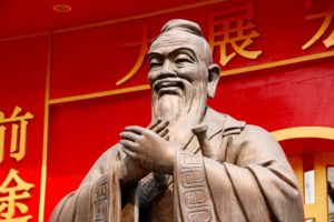 A statue of Confucius wearing a long robe